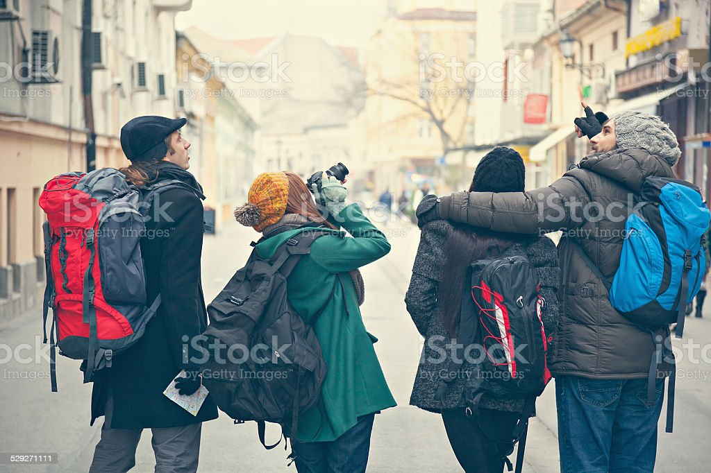 Four Tourists Sightseeing City stock photo