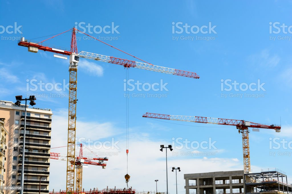 Four tower cranes on a construction site stock photo