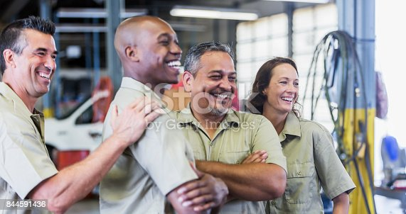 istock Four trucking company workers in garage 844591436