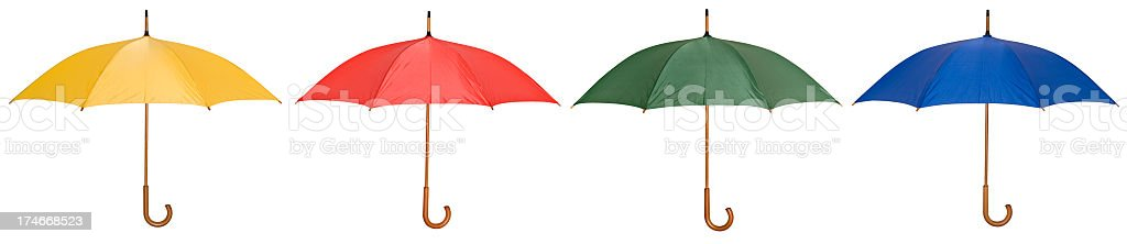 Four umbrellas in yellow, red, green and blue royalty-free stock photo