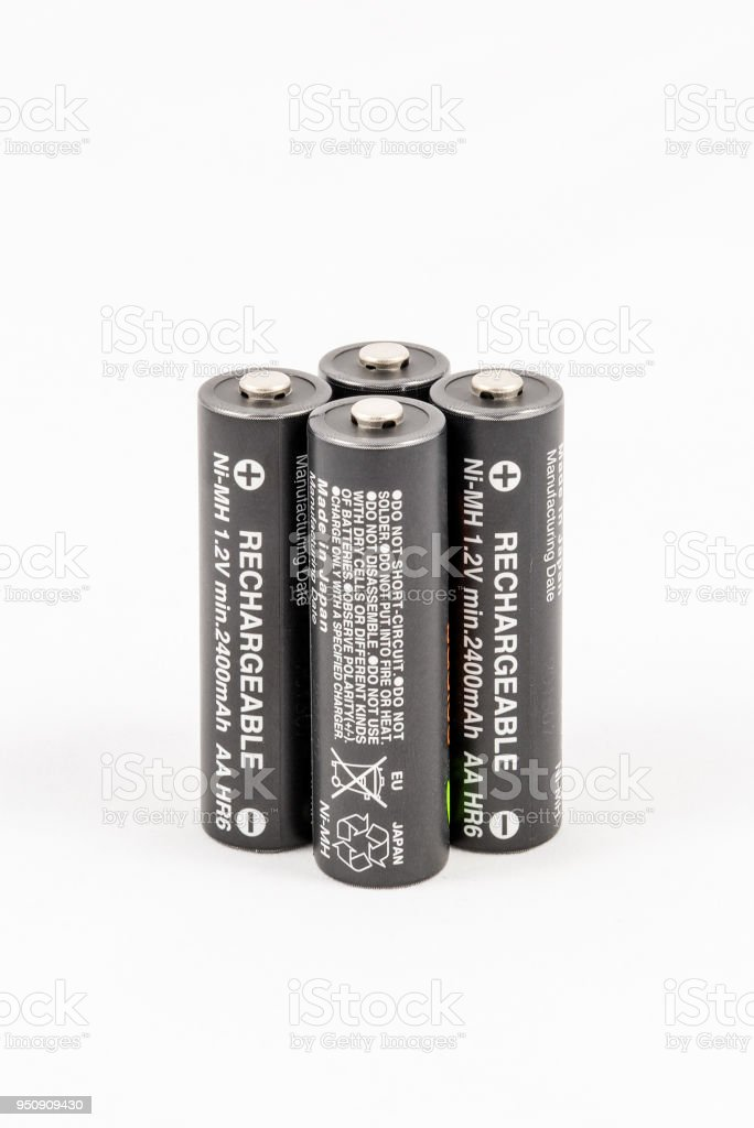 Four unbranded black AA rechargeable batteries stock photo