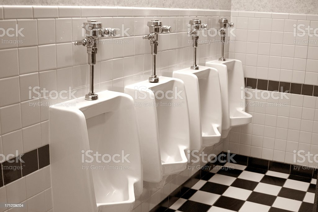 Four Urinals in a row stock photo