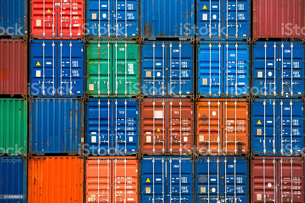 Four vertical rows of shipping containers stock photo