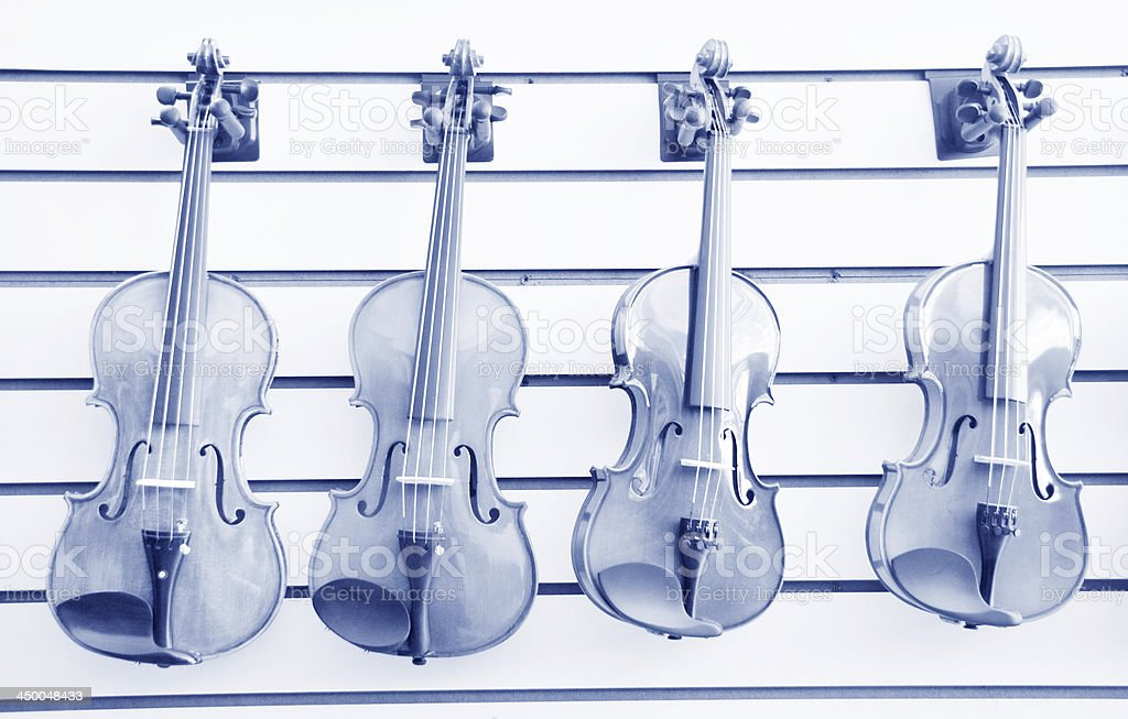 Four violins on the wall royalty-free stock photo