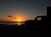 Four Wheel Drive Silhouette on Beach at Sunset