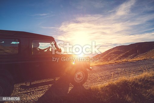 Roaming freely with off-road veicle on mountain at sunset