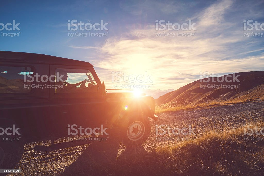 Four Wheel drive on Mountain at Sunset with stock photo