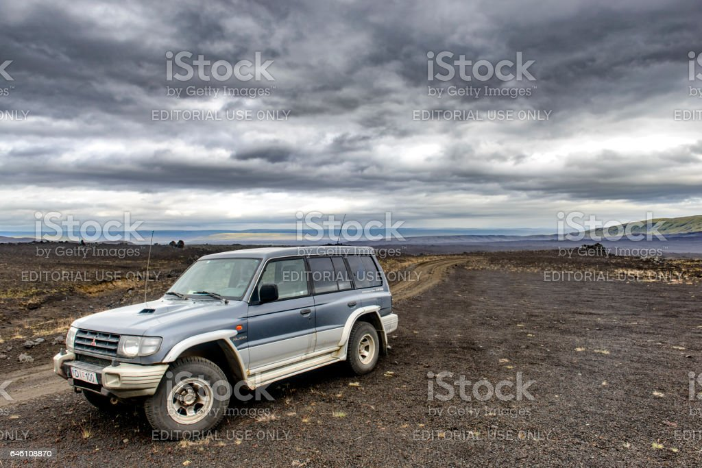 Four wheel drive SUV in a desolate landscape in Iceland stock photo