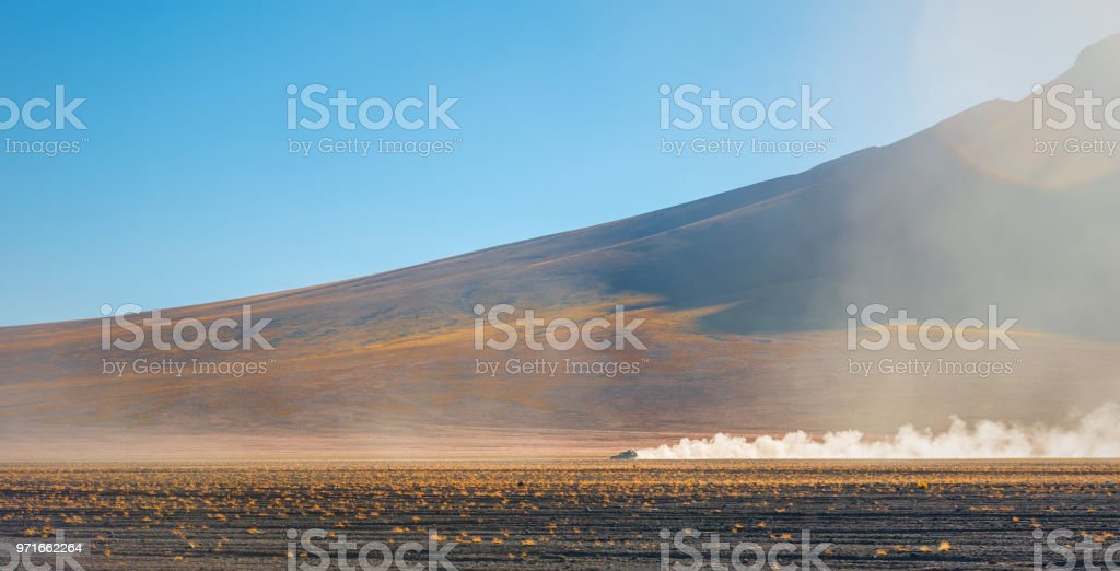 Four wheel drive vehicle in the Andes Mountain Range of Bolivia stock photo