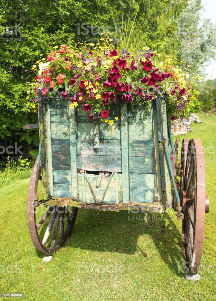 four wheel wagon with flower display stock photo
