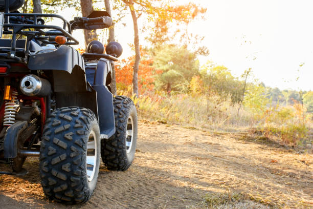 Four wheeler in the nature Four wheeler in the nature quadbike stock pictures, royalty-free photos & images