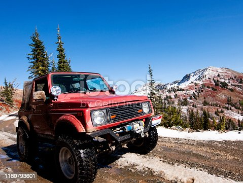 A red 4x4 on Black Lake road in the Seven Devils Mountains near Hells Canyon, Idaho.