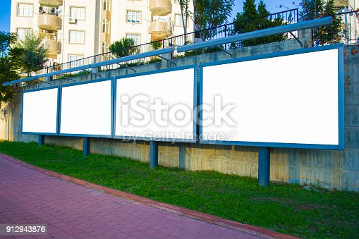 istock four white blank billboard in city center 912943876