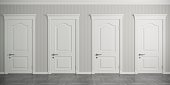 istock Four white classic doors on the wall 1128042331