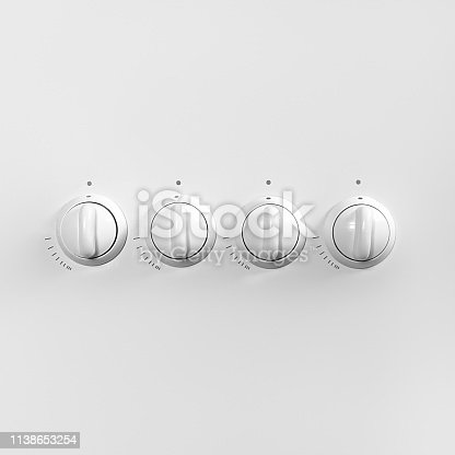 Four white gas stove control knobs. Minimal concept. Copy space for your text or design.