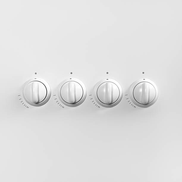 Four white gas stove control knobs. Minimal concept. Four white gas stove control knobs. Minimal concept. Copy space for your text or design. knob stock pictures, royalty-free photos & images