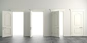 istock Four white open doors on the wall 1128042329