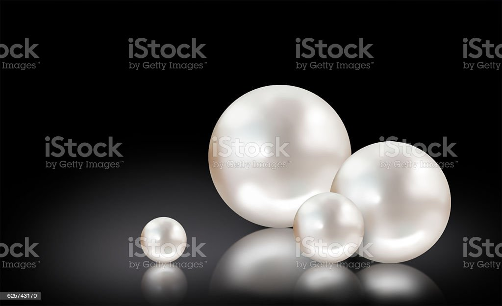 Four white pearls on black background stock photo