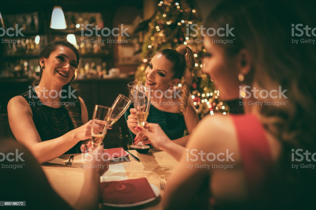 Four women having dinner at the restaurant stock photo
