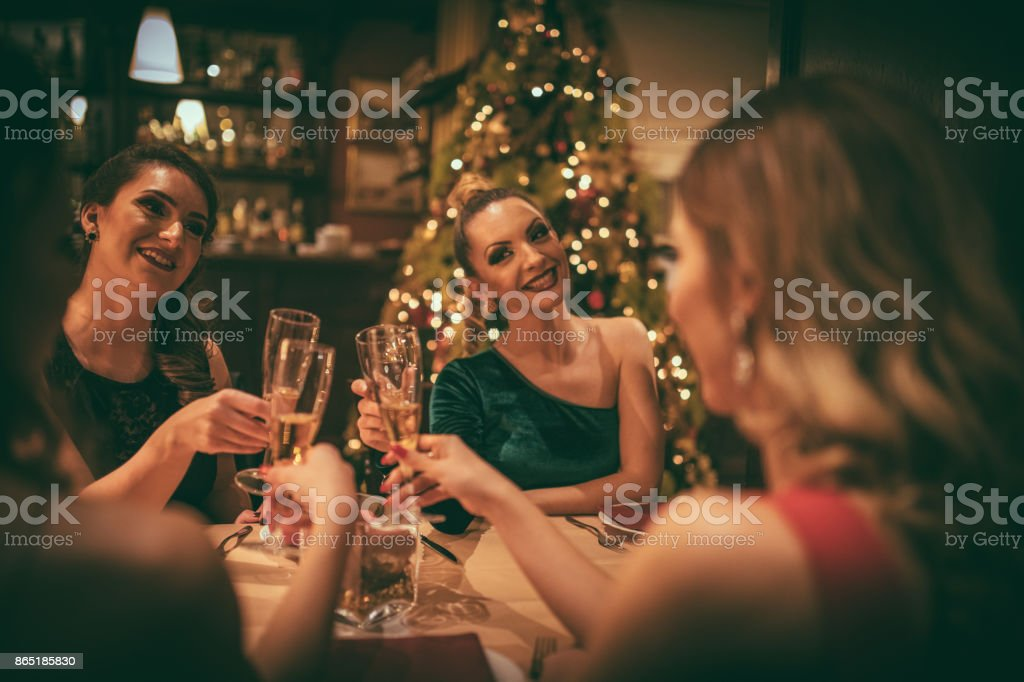Four women having dinner party stock photo