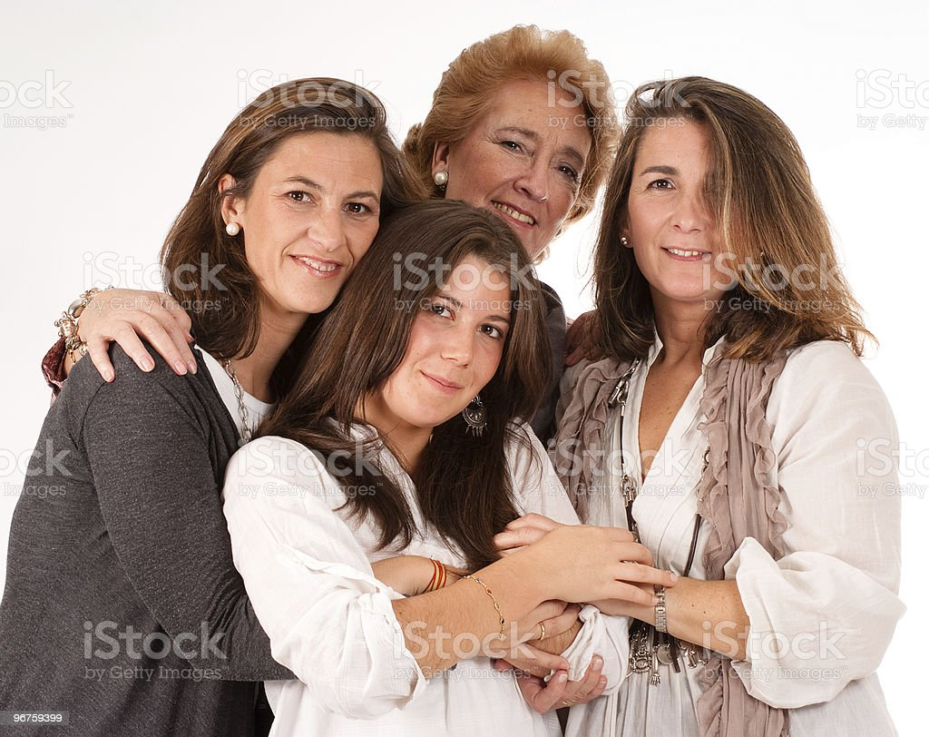 Four women of different ages hugging each other stock photo