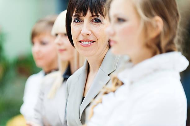 four women office stock photo