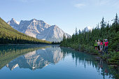 The mountains and forest are reflected in the lake, Yoho National Park, B.C.