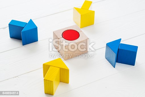 istock Four wooden arrows converge towards the center target. 646694814