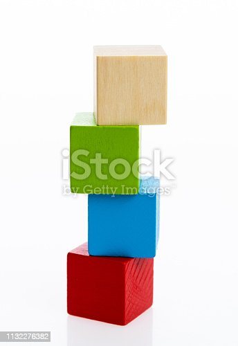 1134528355 istock photo Four wooden blocks on white background 1132276382