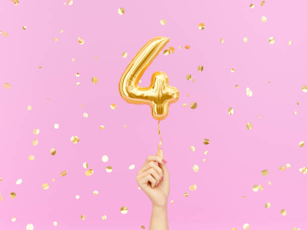 Four year birthday. Four year birthday. Female hand holding Number 4 foil balloon. Four-year anniversary background. 3d rendering number 4 stock pictures, royalty-free photos & images