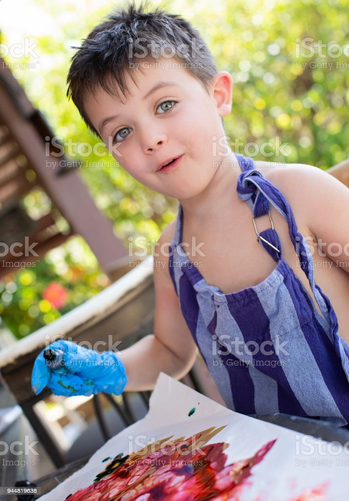 Four Year Old Boy Painting In Backyard Stock Photo - Download Image