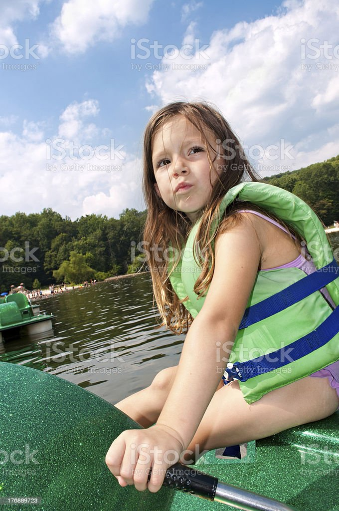 Four Year Old Captain of the Paddle Boat stock photo