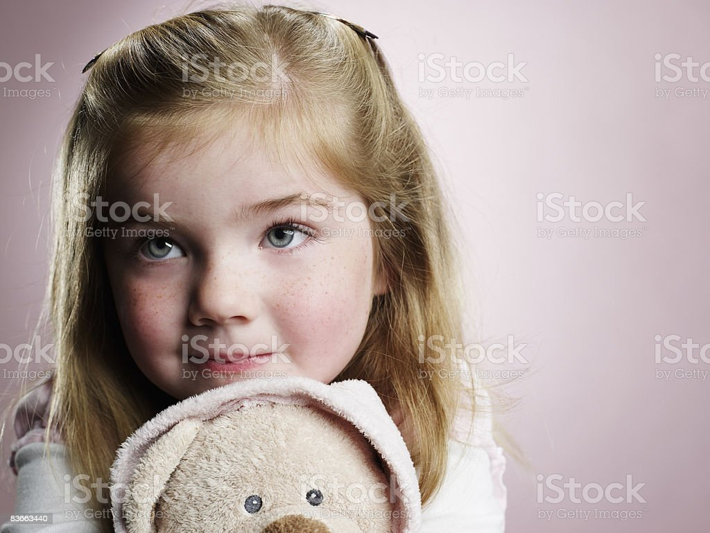 Four year old girl hugging teddy bear. royalty-free stock photo
