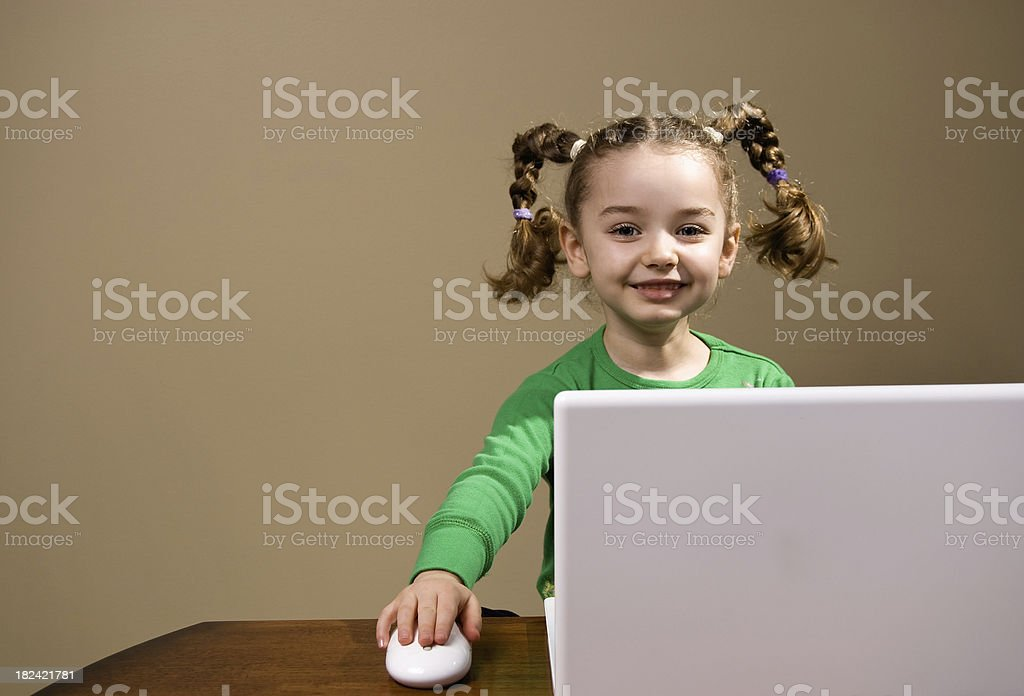 Four year old girl using computer royalty-free stock photo