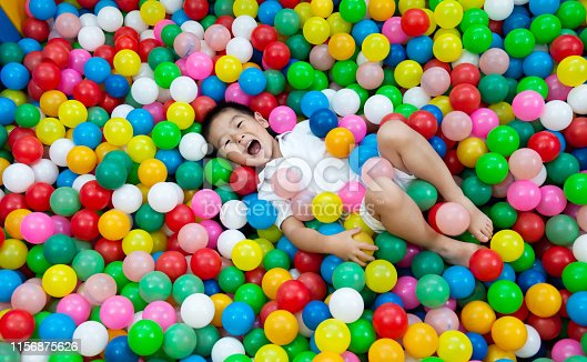 Four years old boy on the ball pool.