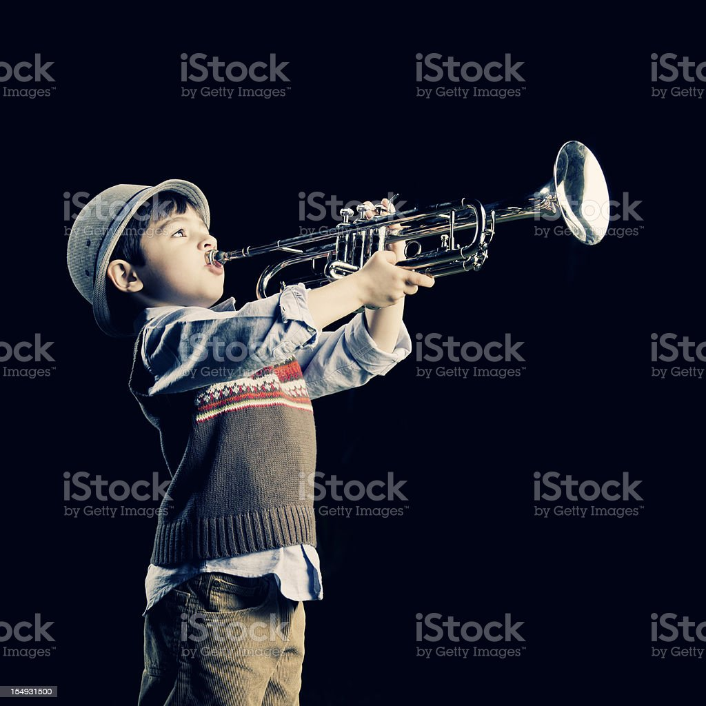 four years old kid playing the trumpet stock photo