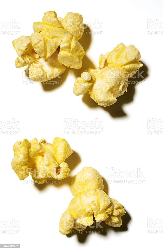 Four Yellow Popcorn Pieces on white stock photo