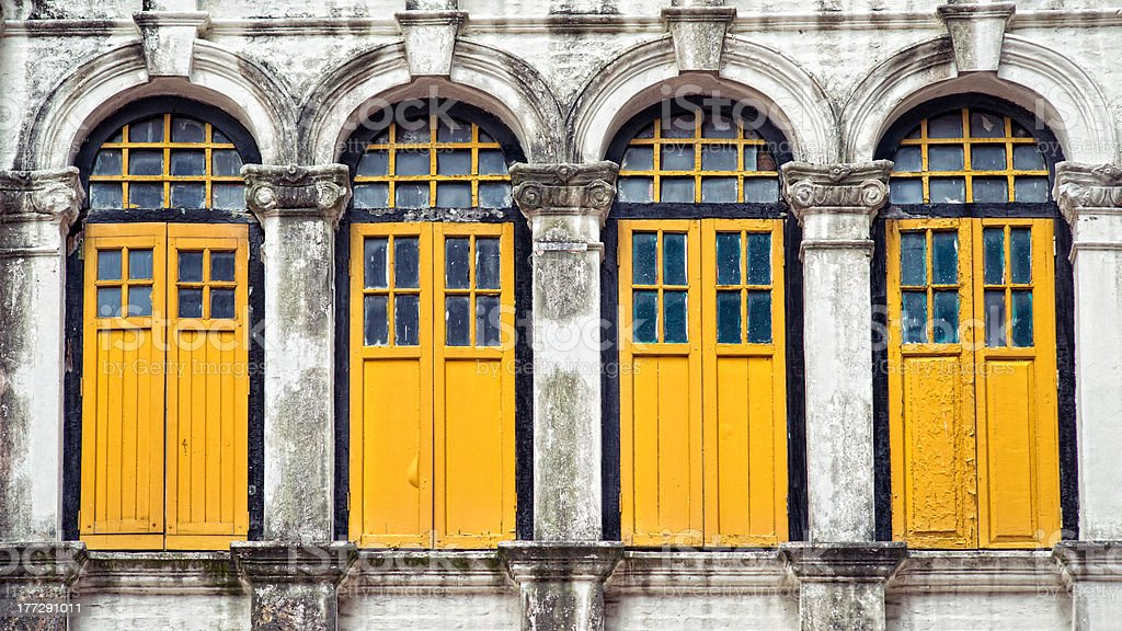 Four yellow windows stock photo