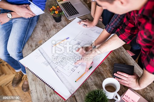 istock Four young architects working on a project, teamwork 499375190