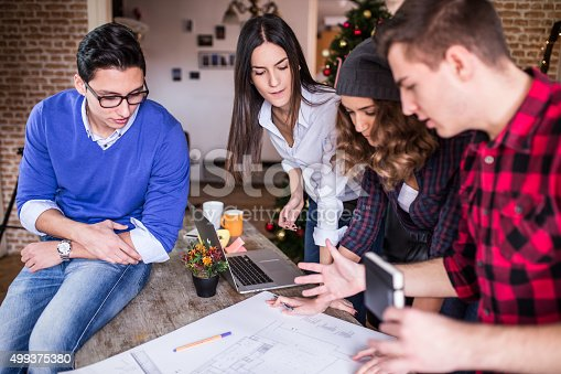 istock Four young architects working on a project, teamwork 499375380