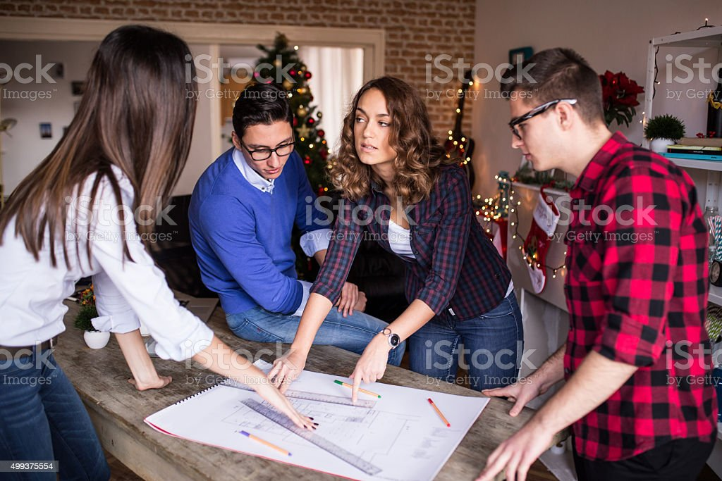 Four young architects working on a project, teamwork stock photo