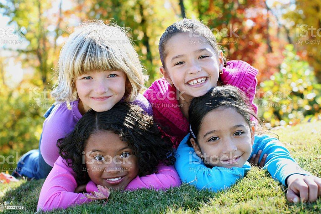 Four young girls having fun outside stock photo