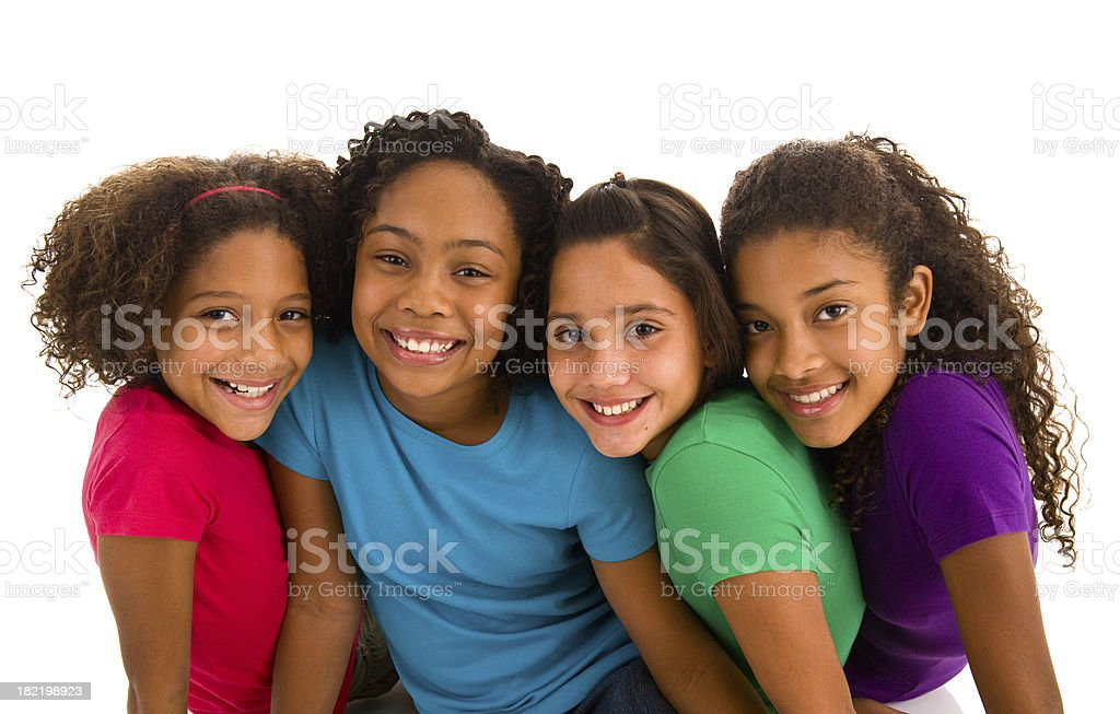 Four young teenage girls sitting close to each other stock photo