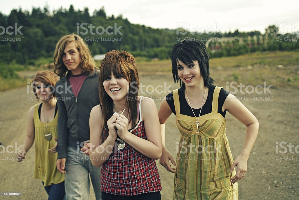 Four Young Teenagers Laughing and Walking royalty-free stock photo