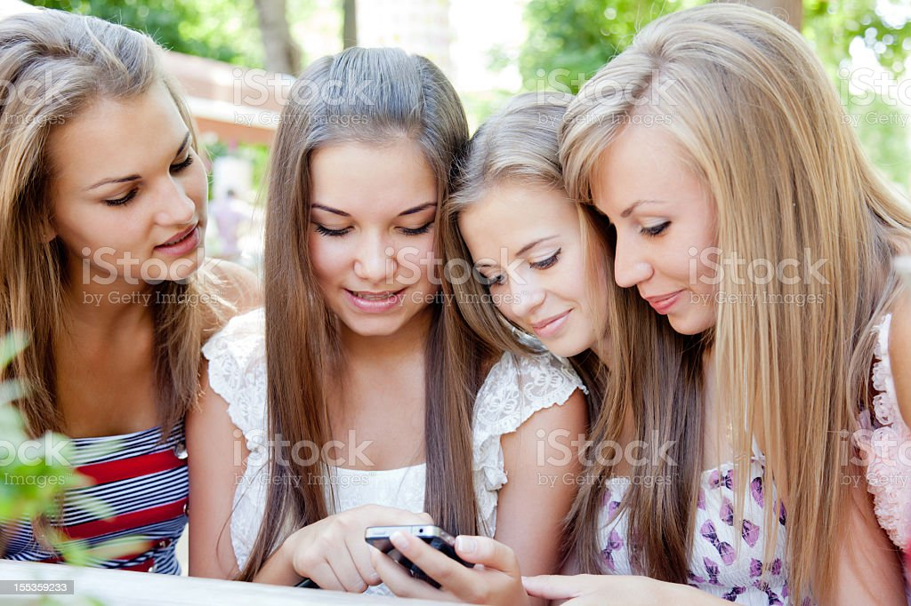 Four young woman in summer outdoors sidewalk cafe royalty-free stock photo