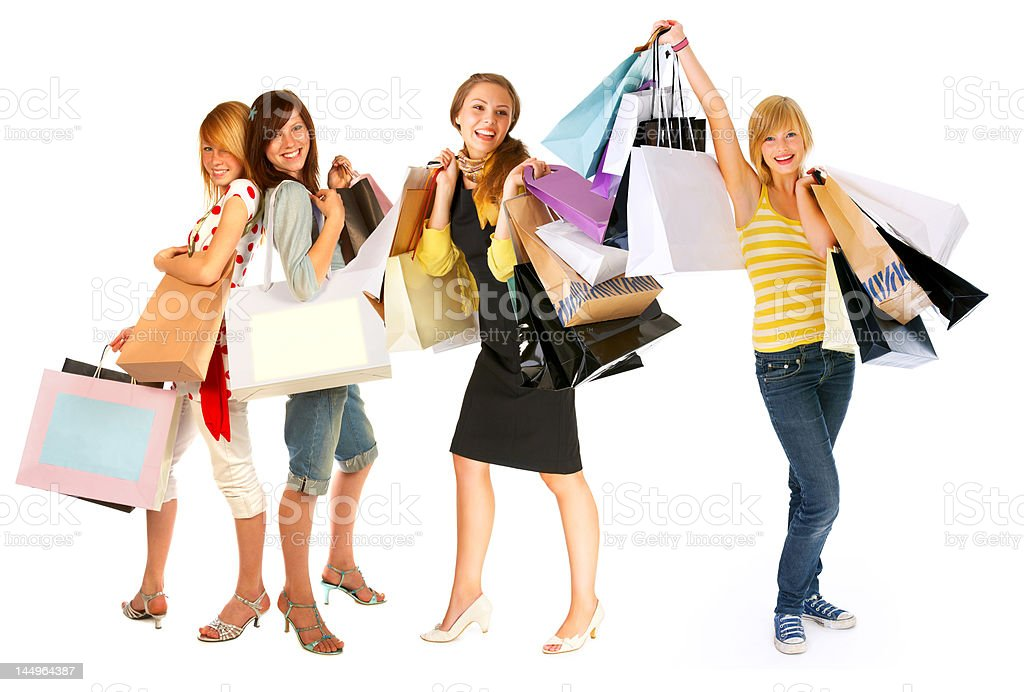 Four young women carrying shopping bags royalty-free stock photo