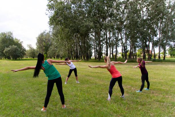 Four young women doing pilates training stock photo