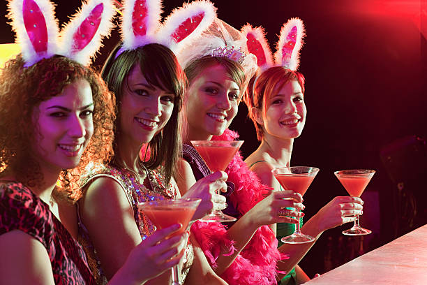 Four young women on hen night stock photo