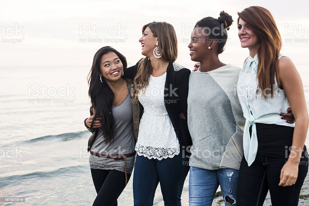 Four young women walking in the city royalty-free stock photo