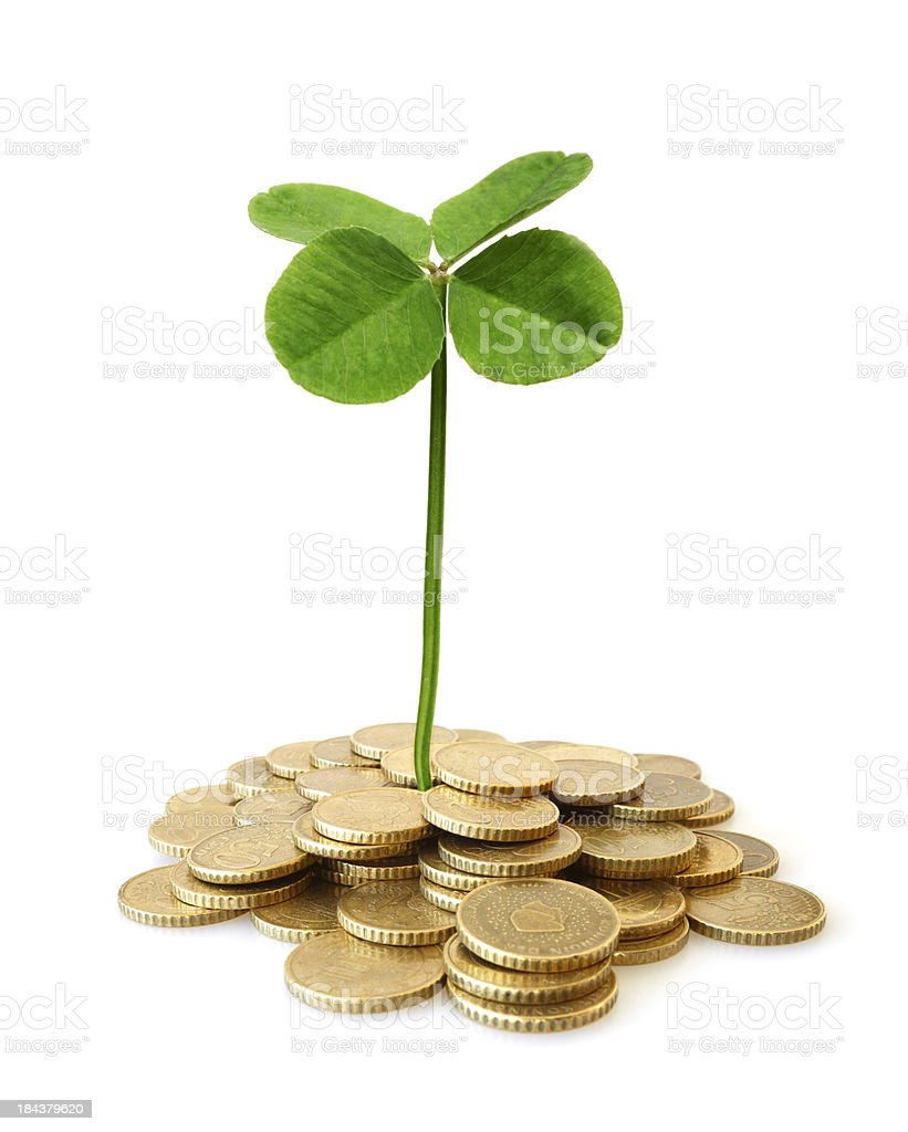 Four-Leaf Clover Growing from Pile of Money royalty-free stock photo